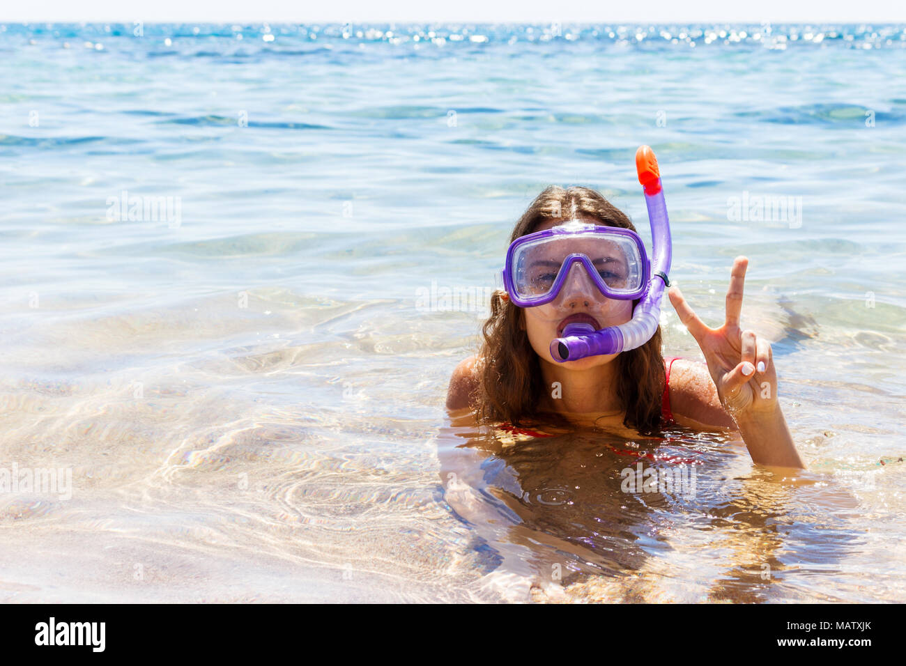 A young girl diving mask snorkel stock photos a young for Dive tube
