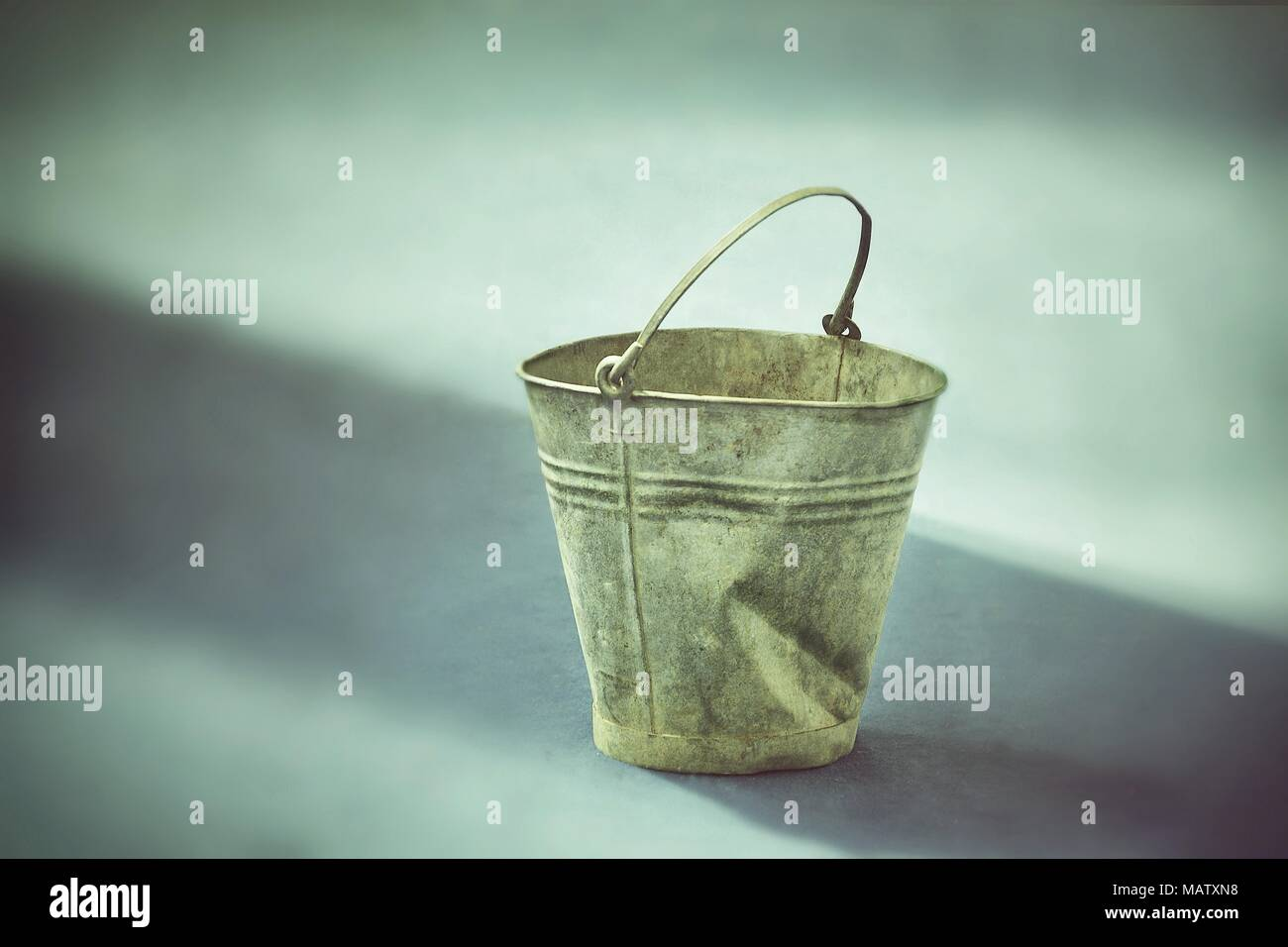 Rustic old fashioned dented bucket - Stock Image