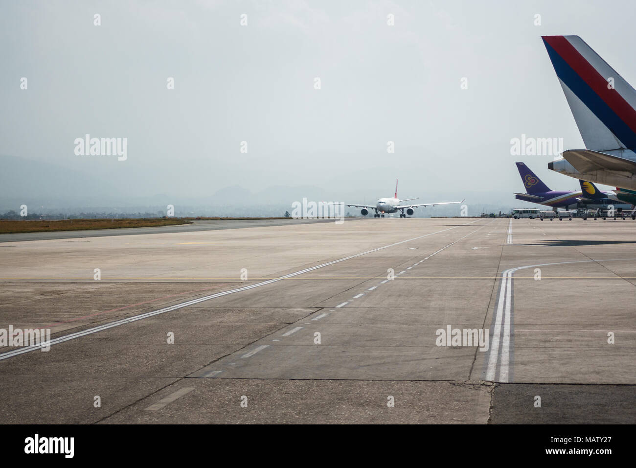 KATHMANDU, NEPAL - CIRCA MARCH 2108: Airplane taxiing at Tribhuvan International Airport. - Stock Image