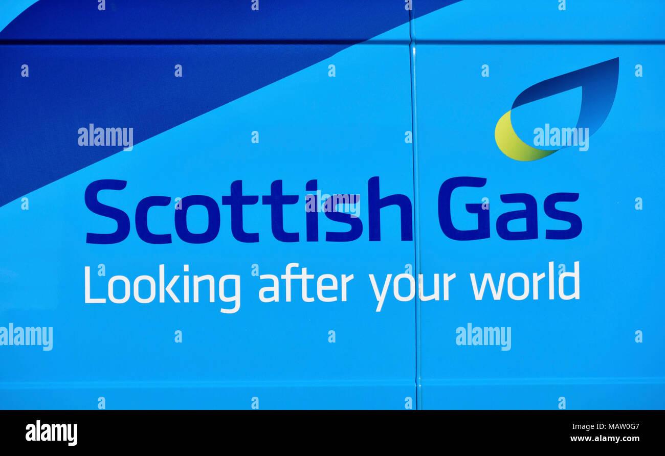 'Scottish Gas Looking after your world' logo on side of British Gas van. Kendal, Cumbria, England, United Kingdom, Europe. - Stock Image