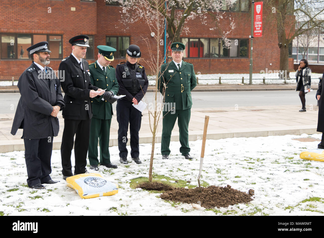 Members of Barnet's emergency services at multi faith tree planting ceremony at Middlesex University - Stock Image