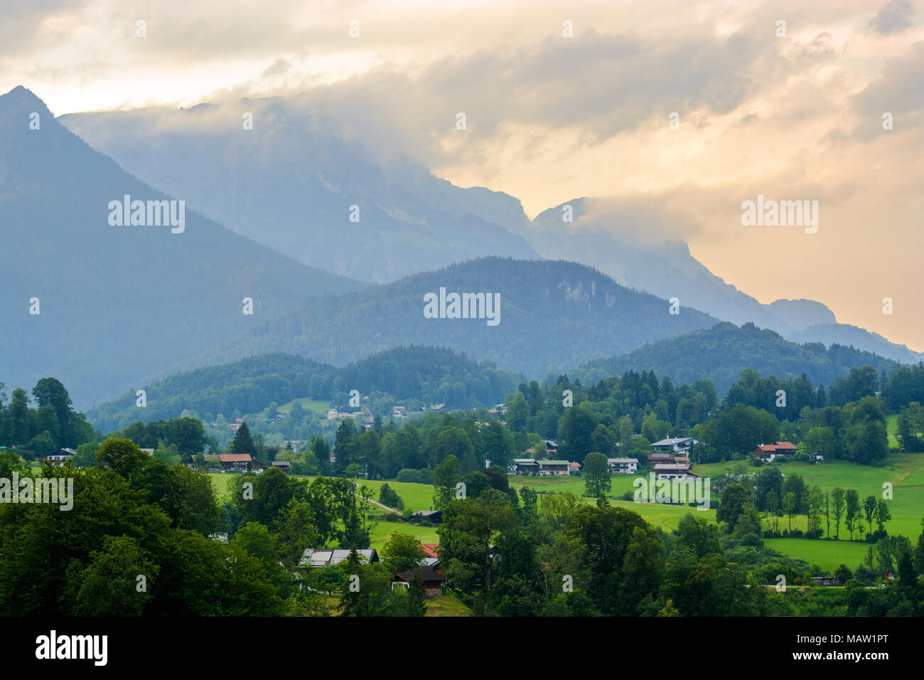 Rural summer landscape with country houses in Alps in early morning - Stock Image