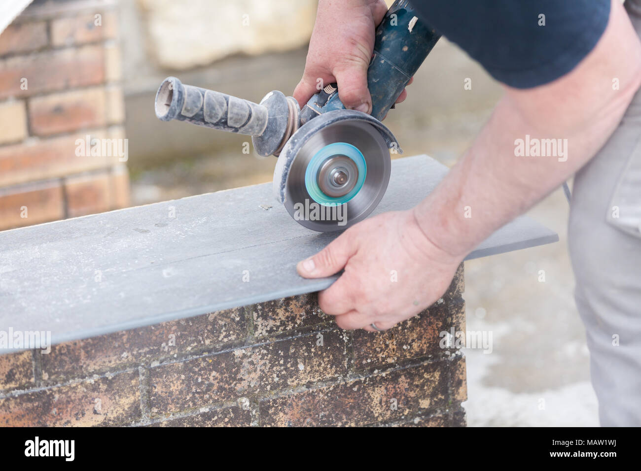 Electric tile cutter stock photos electric tile cutter stock tiler cutting a tile with a grinder stock image dailygadgetfo Choice Image