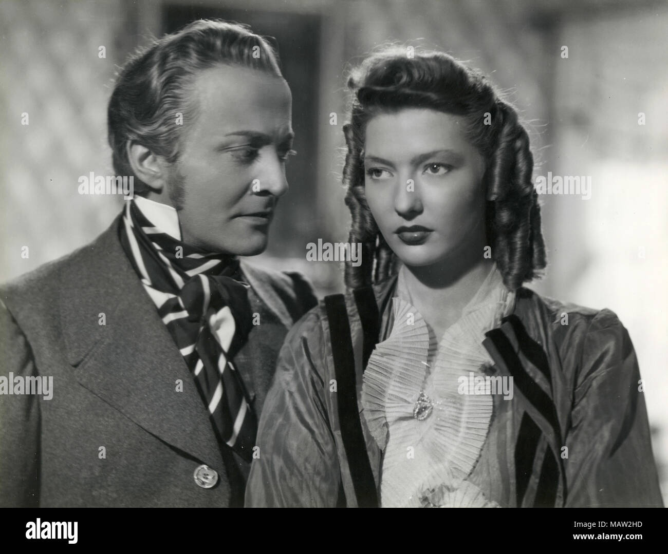 French actress Corinne Luchaire and Argentinian actor George Rigaud in the movie Abbandono, 1940 - Stock Image