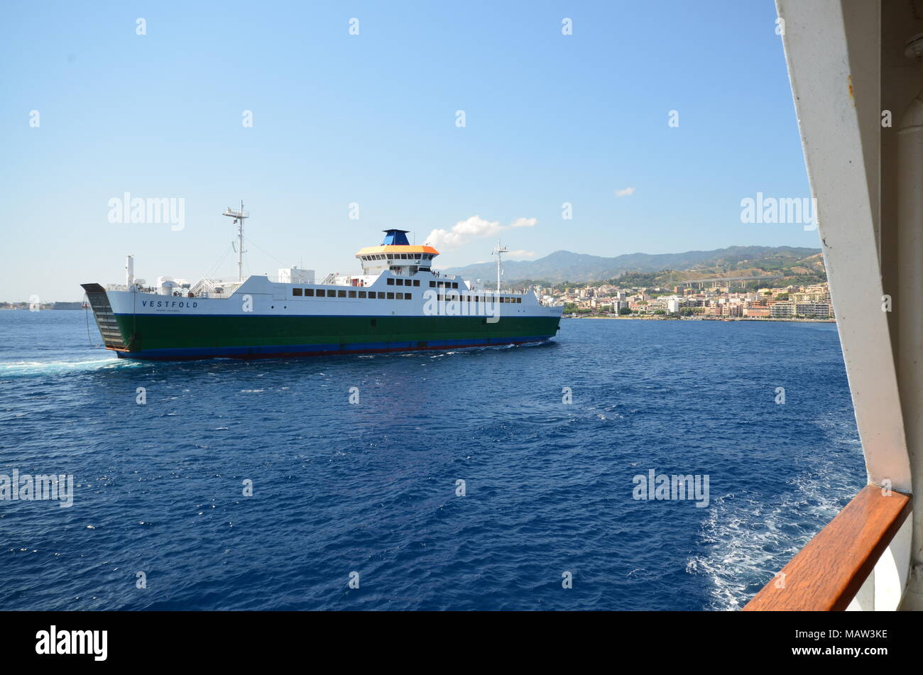Messina, Italy, Sicily August 15 2015. After queuing the car, embark the car on the ferry that connects Italy to Sicily. - Stock Image