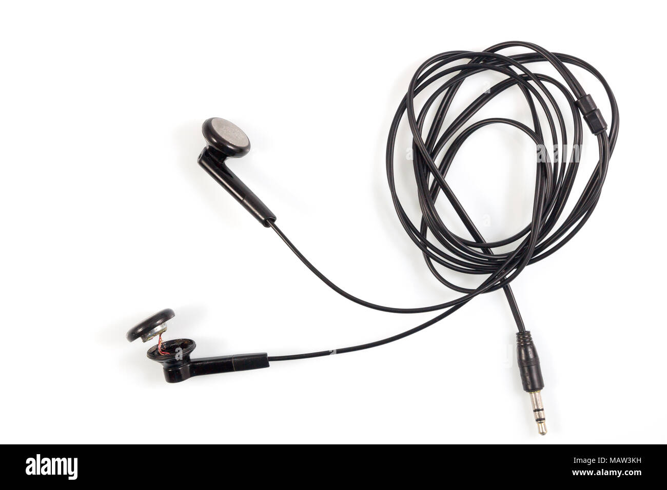 Top view of broken old black earphones or headphones on white ...