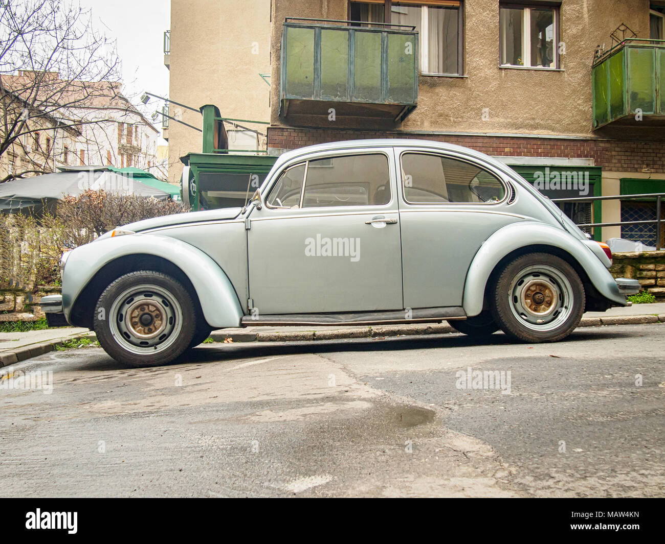 BUDAPEST, HUNGARY-MARCH 31, 2018: Silver Volkswagen Beetle (Type 1) in the city streets - Stock Image