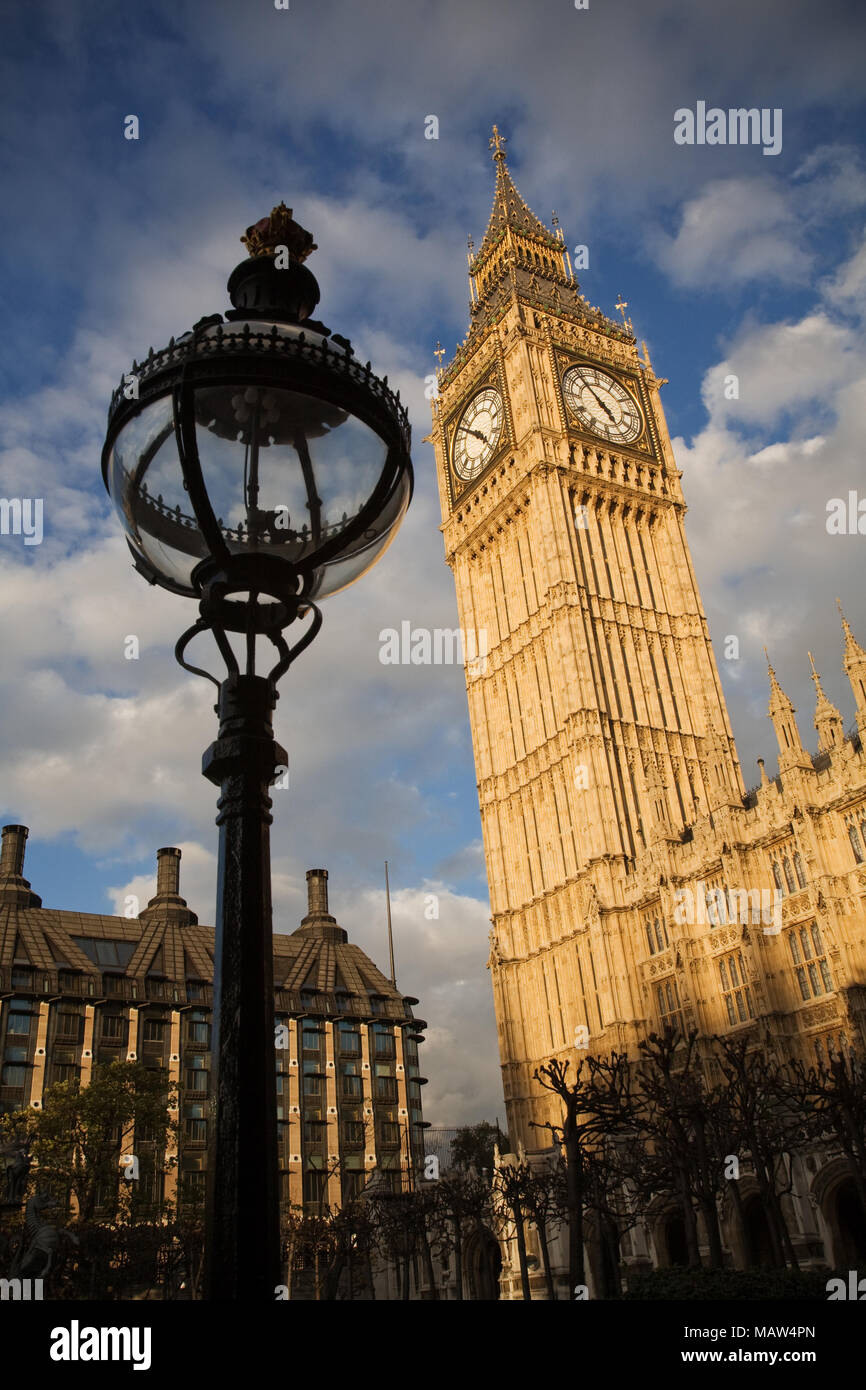 Elizabeth Tower or Big Ben and the Palace of Westminster in London, England, UK. Portculis house can be seen in the background. - Stock Image