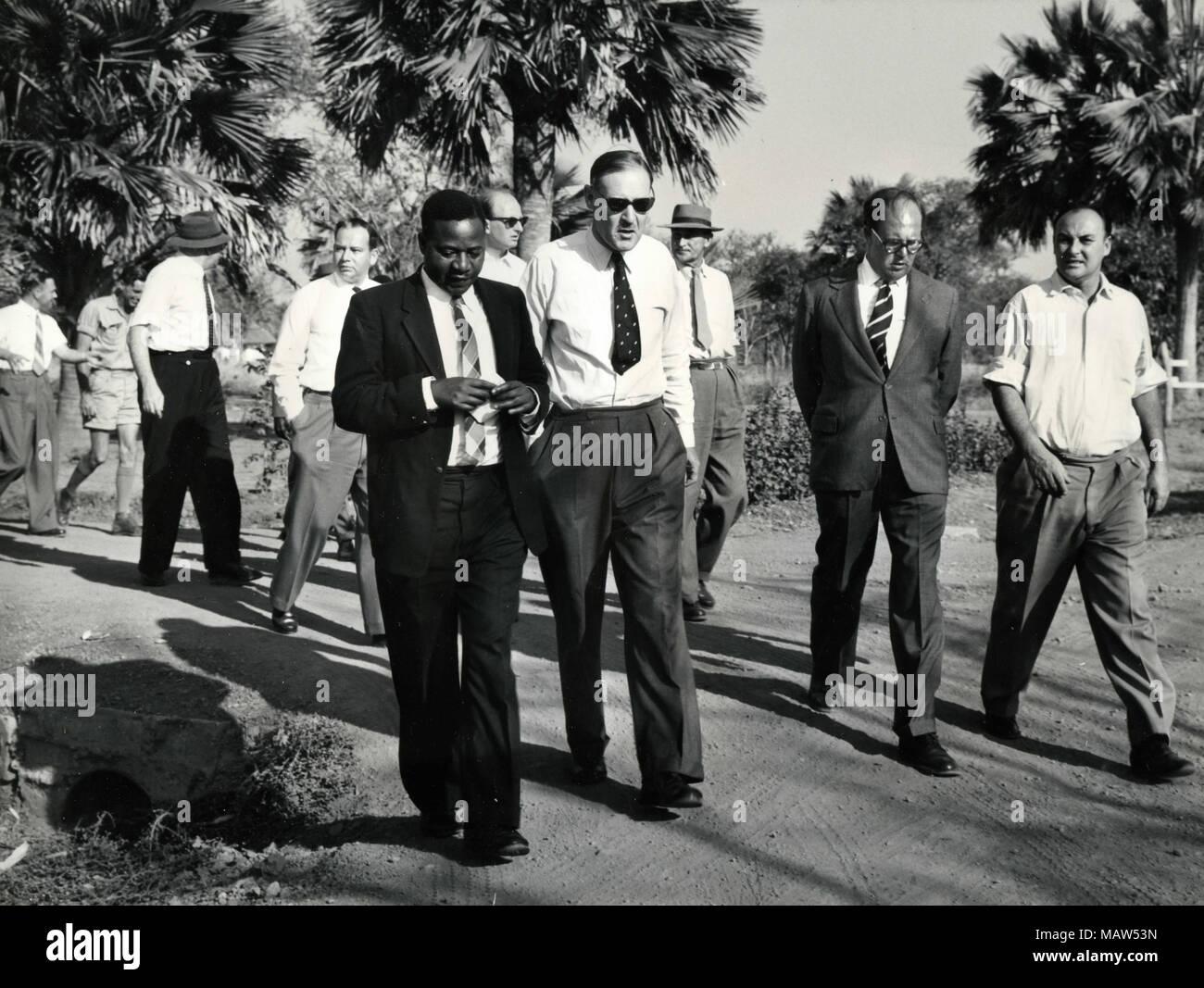 E. Mwamba, C.W. Lynn, R.E. Sicely, and John Roberts of Rhodesian Selection Trust, Kafue Pilot Polder, Zambia, South Rhodesia 1959 - Stock Image