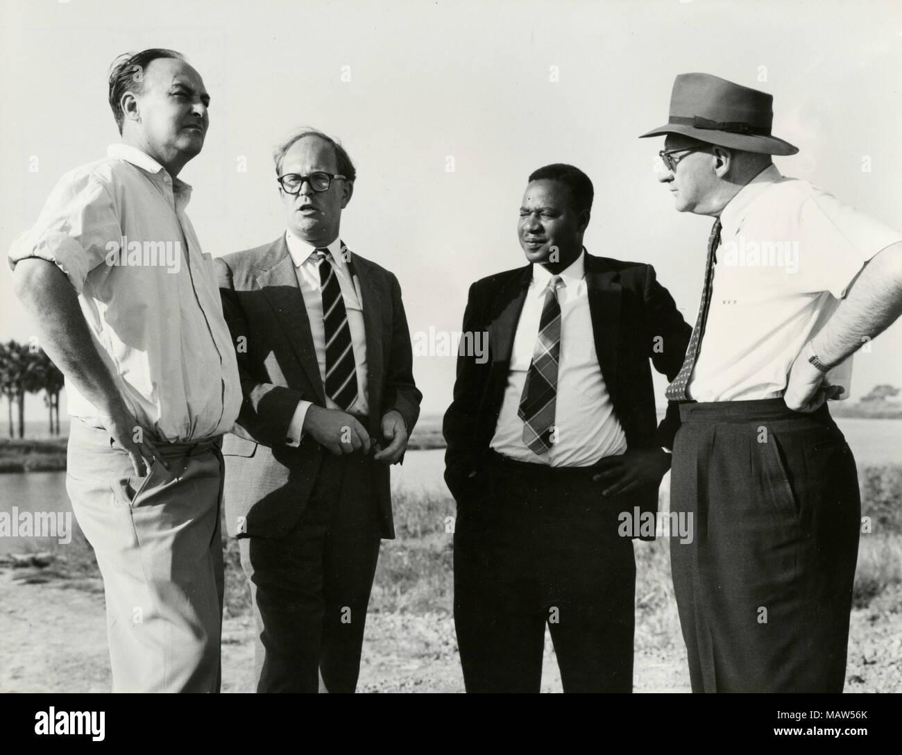 John Roberts, E.M.  Sicely,E. Mwamba, and M.G. Rabb of Rhodesian Selection Trust, Kafue Pilot Polder, Zambia, South Rhodesia 1959 - Stock Image