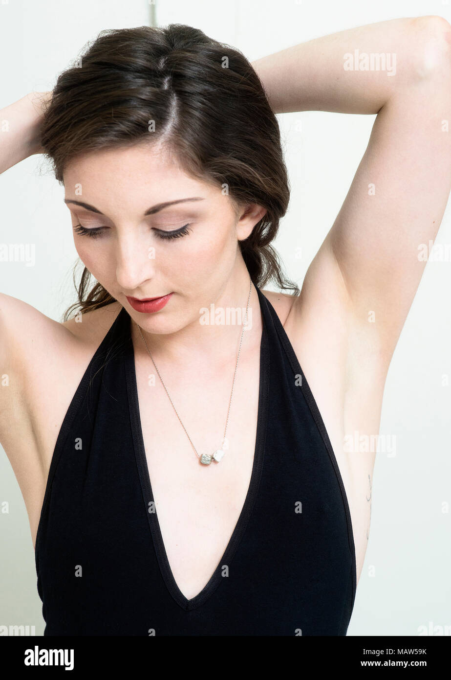 A portrait of a woman wearing a necklace. Stock Photo