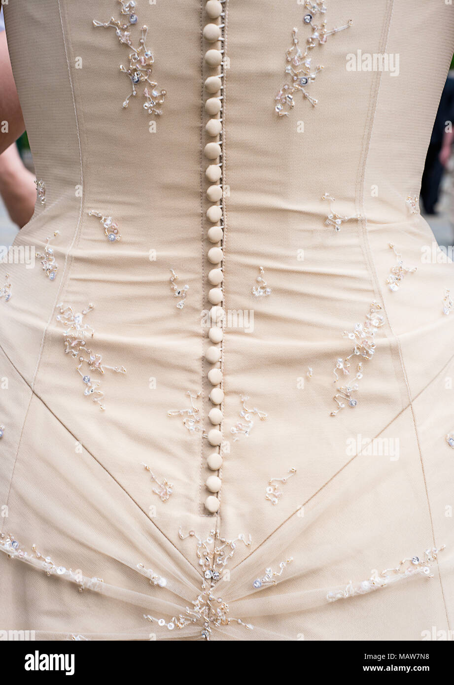 The buttons on the bodice of a wedding dress. - Stock Image
