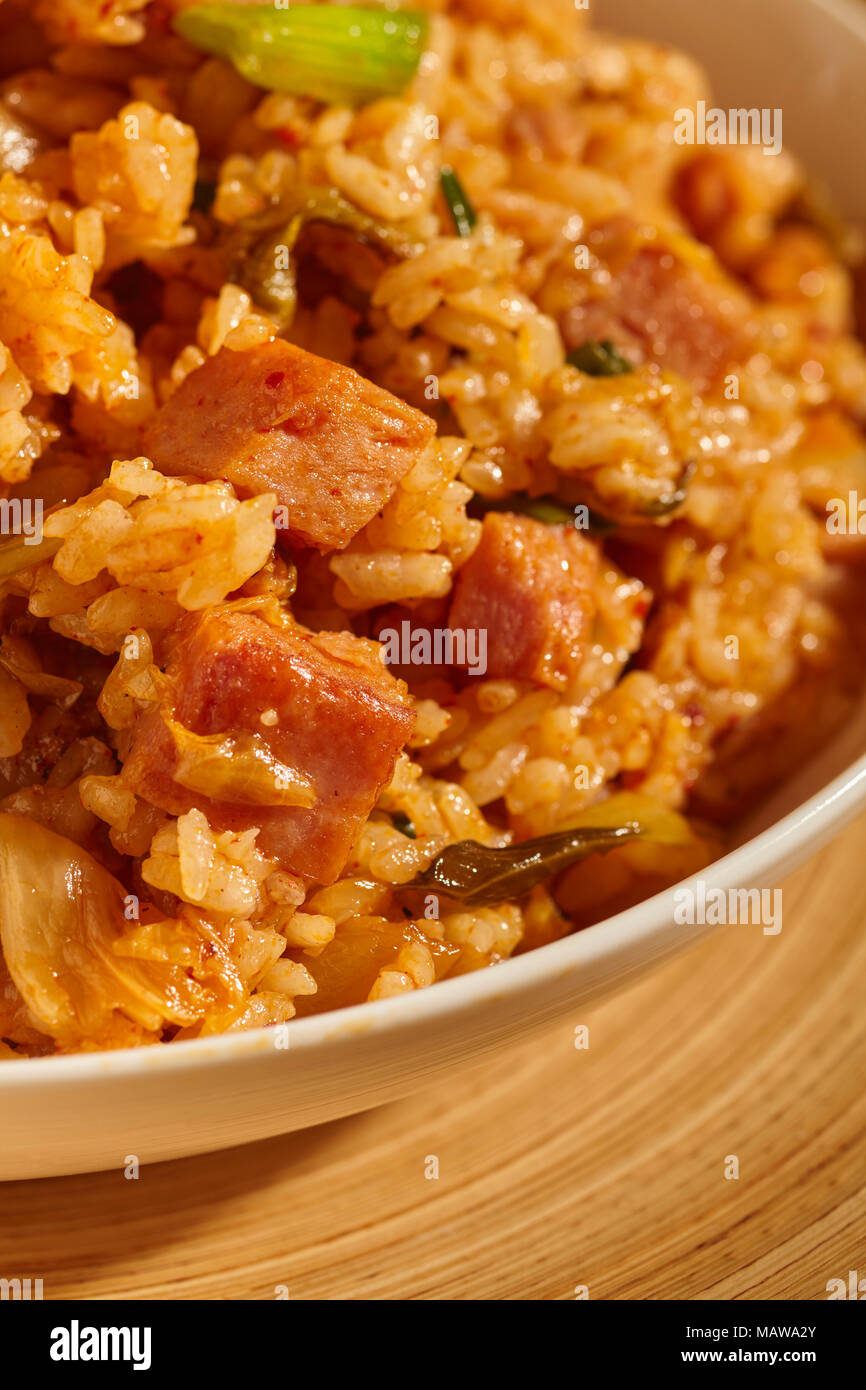 A bowl of Spam and Kimchi fried rice, a classic dish in Korean home cooking - Stock Image