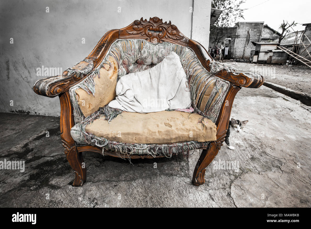 Tatty old chair in Indonesian kampung (Village) Stock Photo