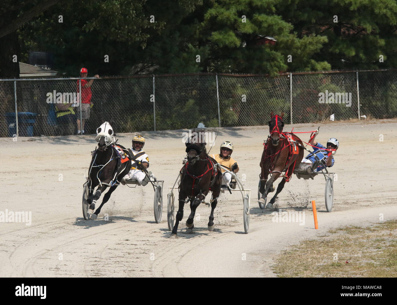 Male riders. Horse Harness Racing. Canfield Fair. Mahoning County Fair. Canfield, Youngstown, Ohio, USA. - Stock Image