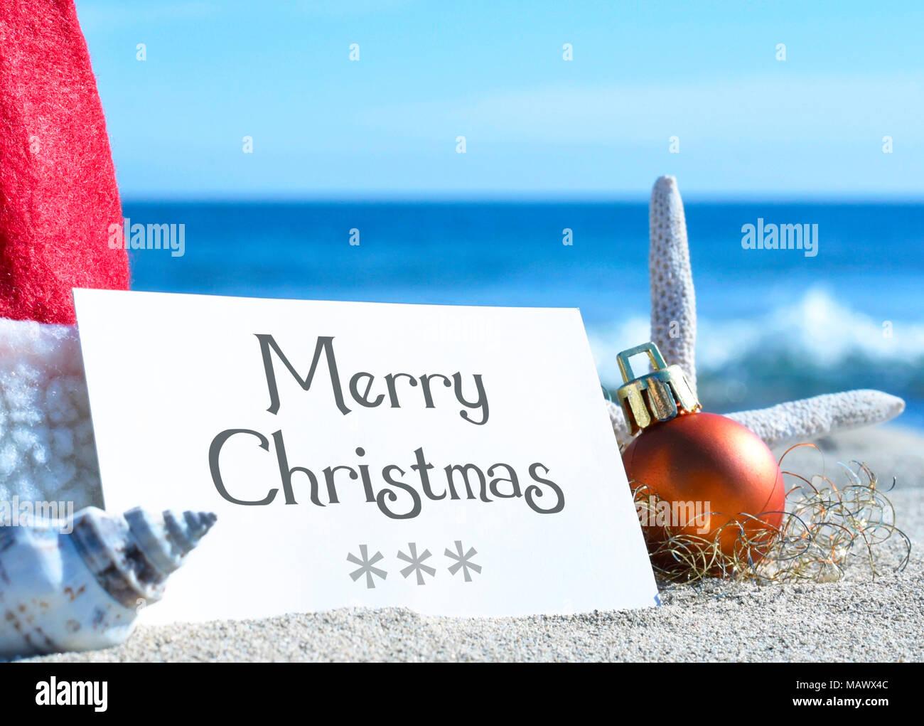 Christmas greeting card and christmas decoration on the beach. Beach ...