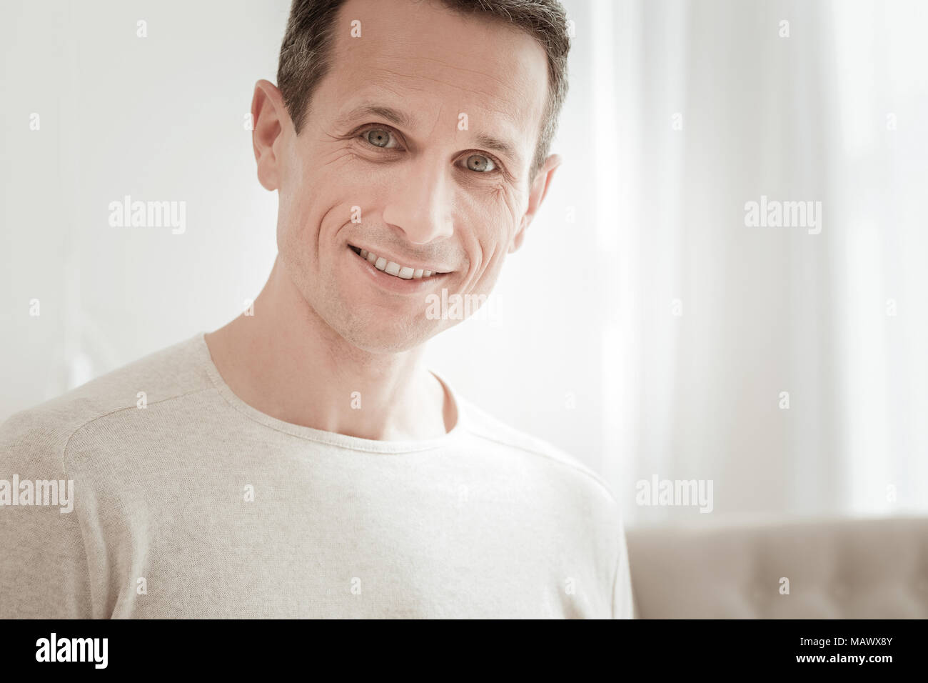 Joyful happy man looking straight and smiling. Stock Photo