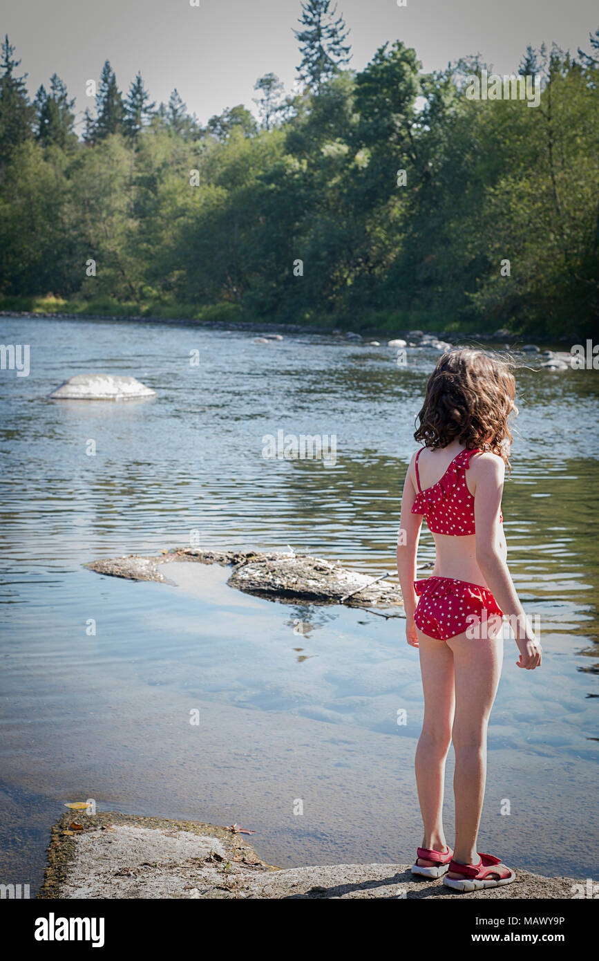 b5cdc0a680f9a A young girl in a bathing suit standing next to the North Santiam River.