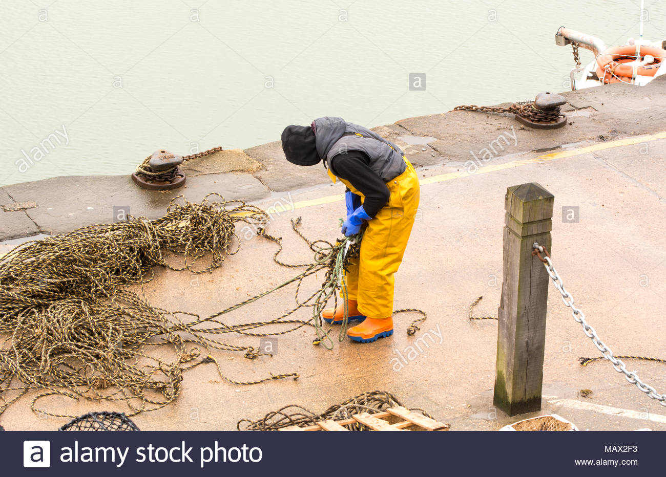 Man working on the quayside - Stock Image