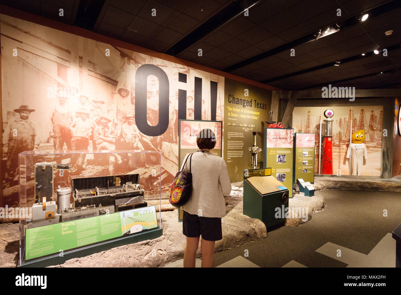 A tourists learning about the history of oil in Texas; Texas State History Museum, Austin Texas USA - Stock Image