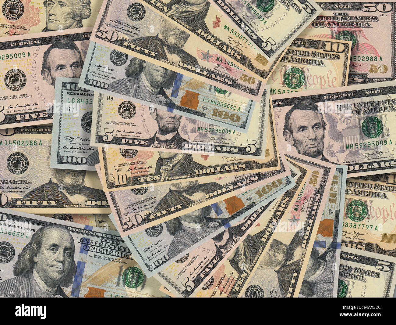 Fan of american dollar bills money of various currencies in close up on background of pile of dollar bills - Stock Image