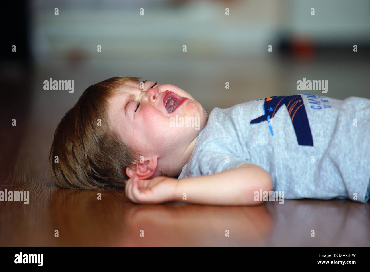 Montreal,Canada,8,August,2017.A 2 year old child having a temper tandrum on floor.Credit:Mario Beauregard/Alamy Live News - Stock Image