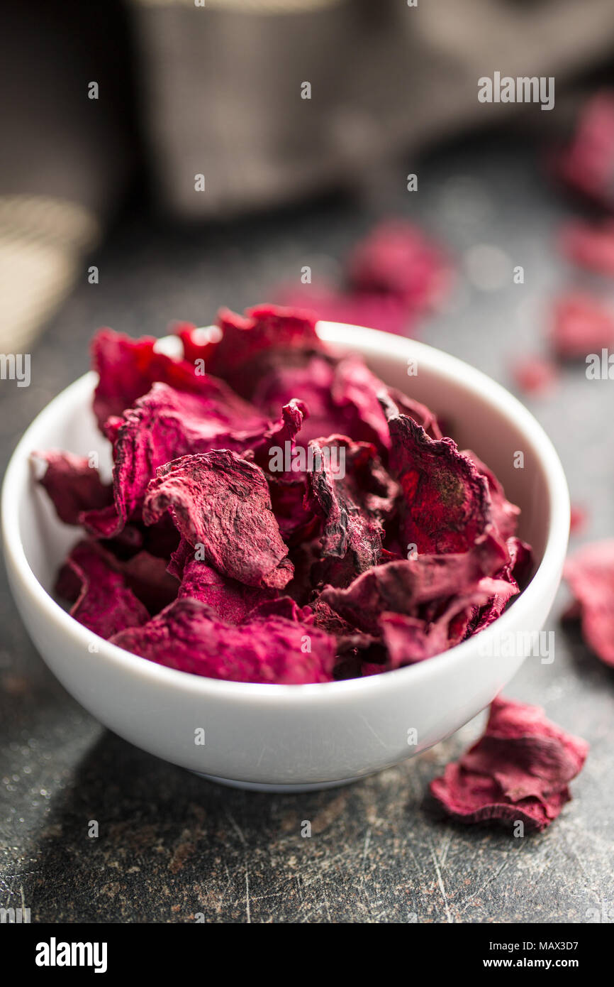 Dried beetroot chips in bowl. - Stock Image