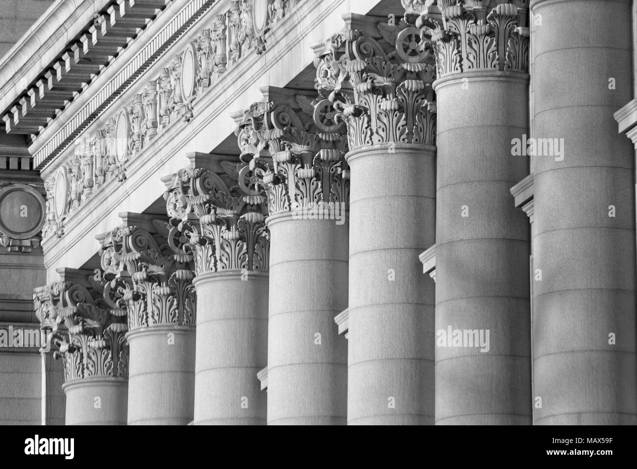 A series of Corinthian Columns shot at sunset in Black & White, this was taken in lower Manhattan at the old customs house i Stock Photo