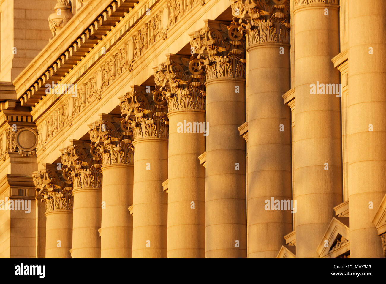 A series of Corinthian Columns shot at sunset, this was taken in lower Manhattan at the old customs house Stock Photo