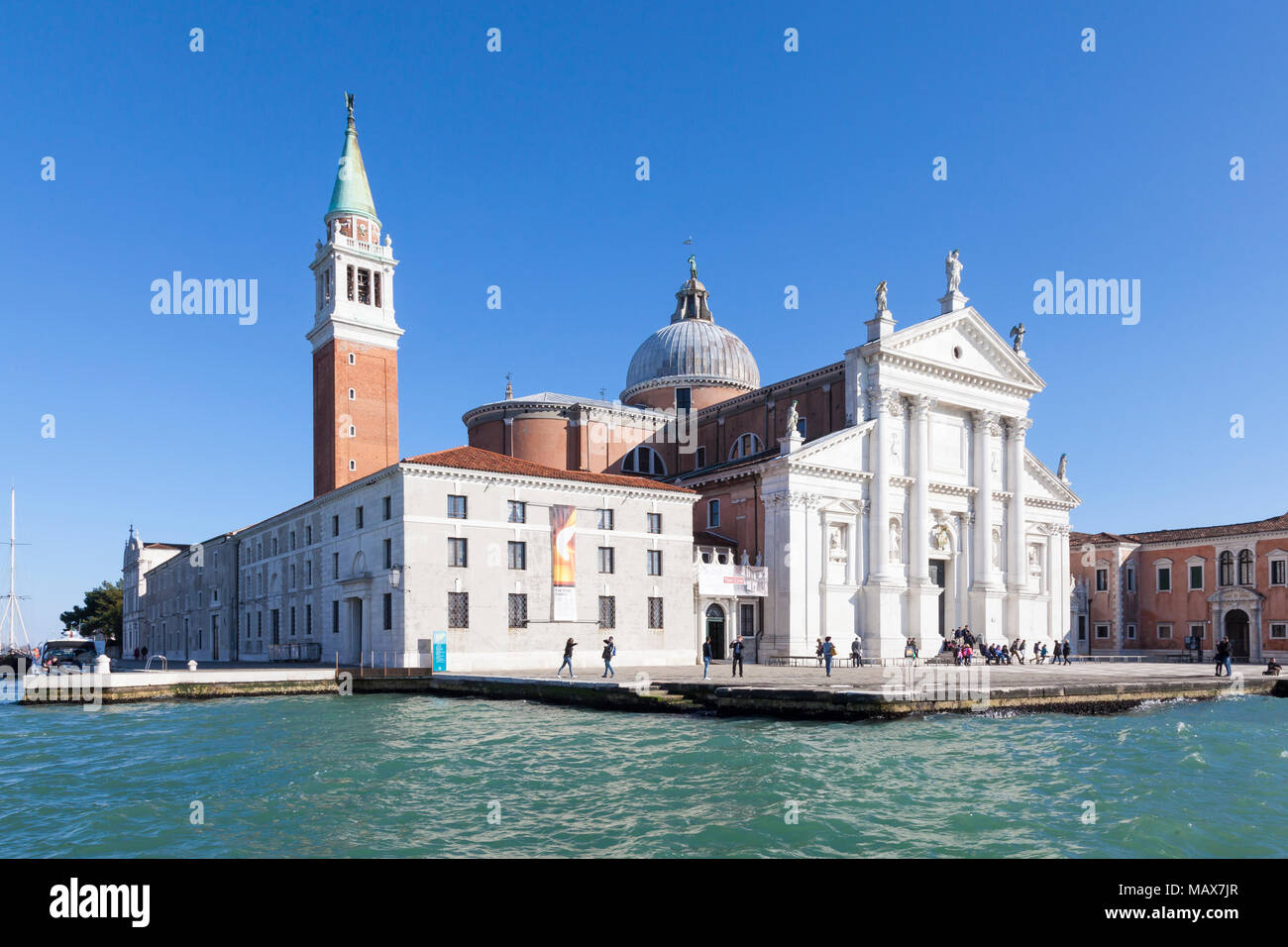 Isola di San Giorgio Maggiore from Basino San Marco and the  Giudecca Canal, Venice, Veneto, Italy on a blue sky sunny day. Designed by Palladio - Stock Image