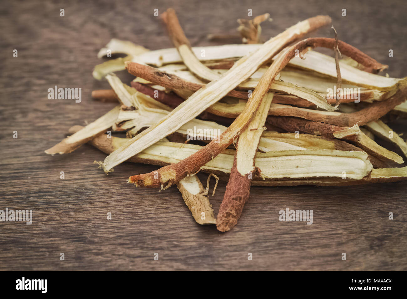 Liquorice root baked used in chinese herbal medicine - Stock Image