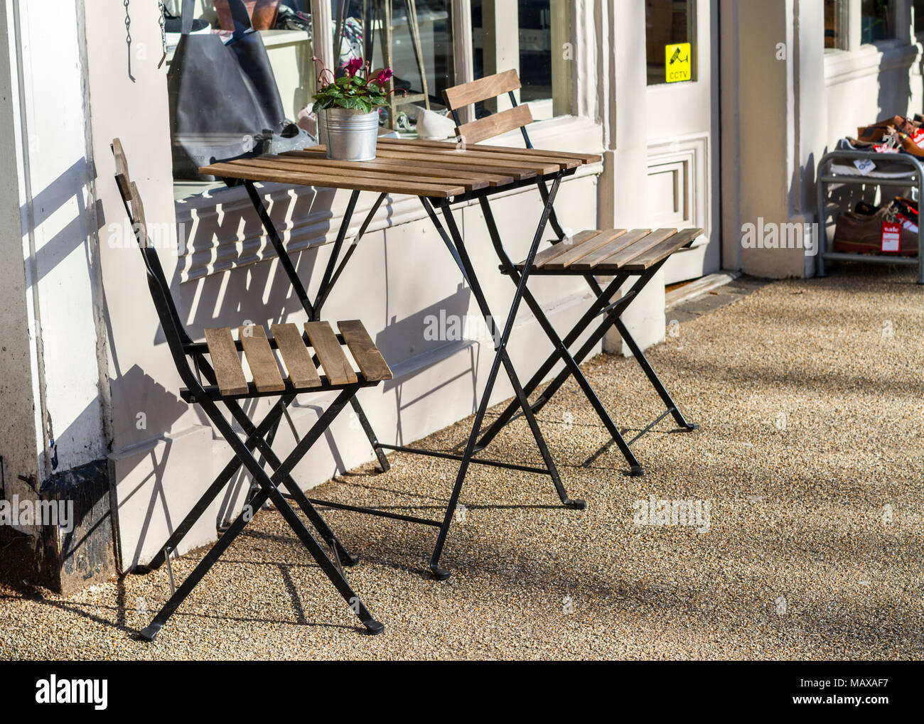 Empty Wooden Table And Chairs Outside A Coffee Shop On A