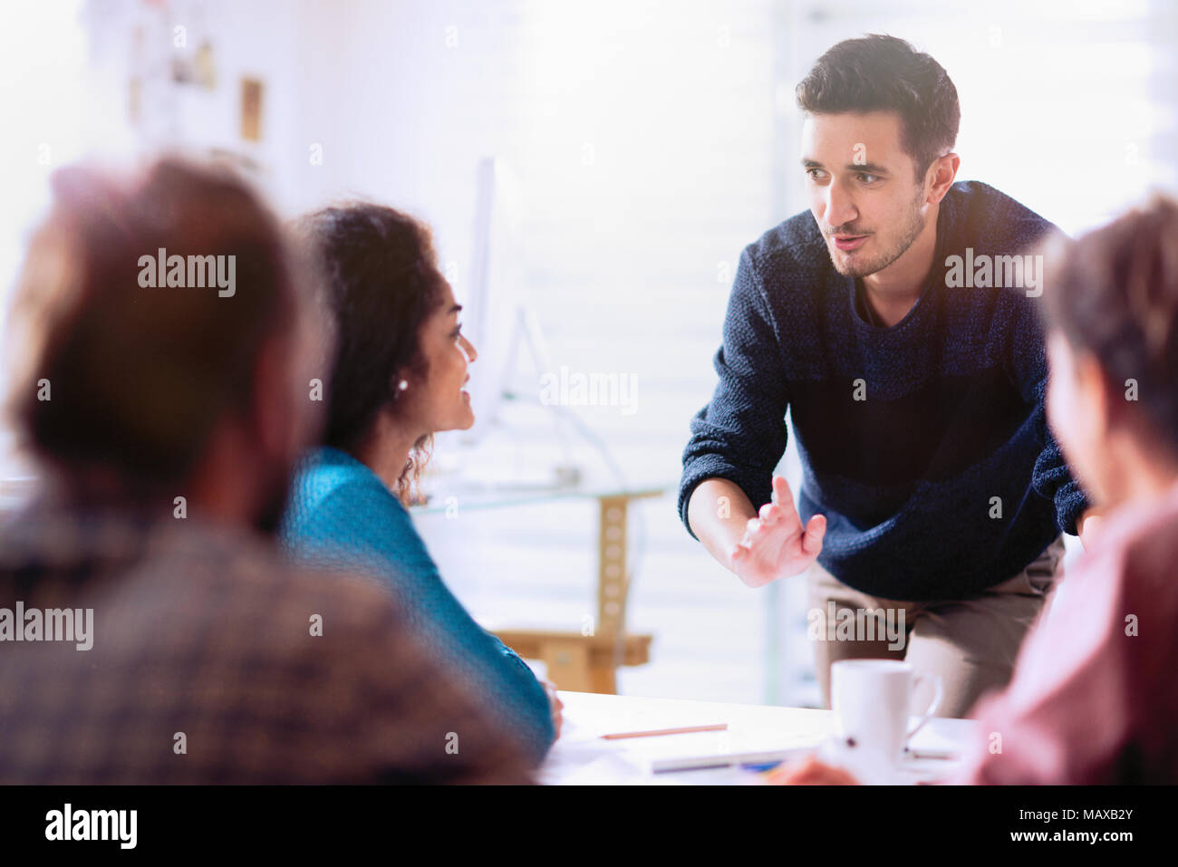 in a meeting. A young man presenting his project - Stock Image