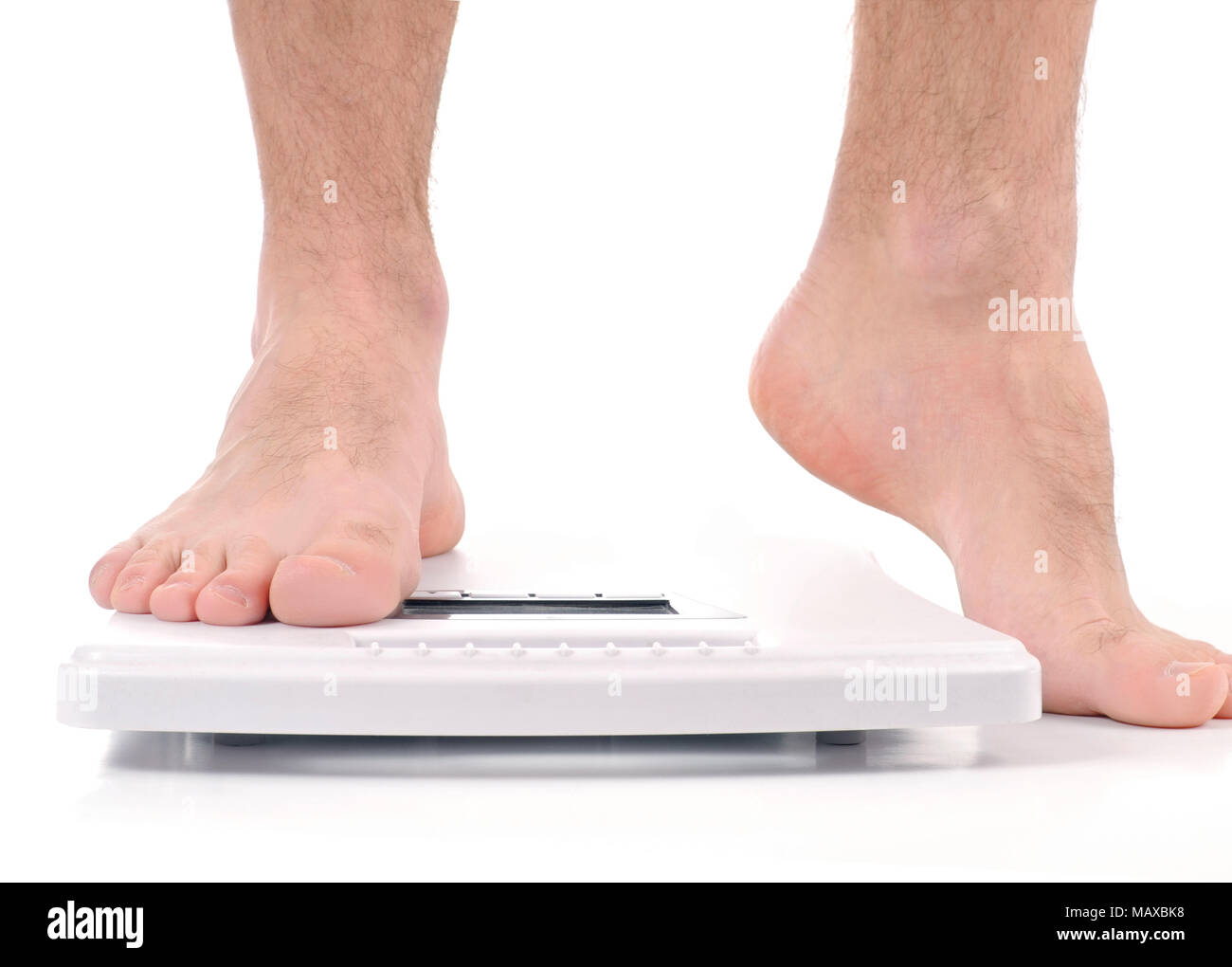 Diet concept. Man standing on weight scale - Stock Image