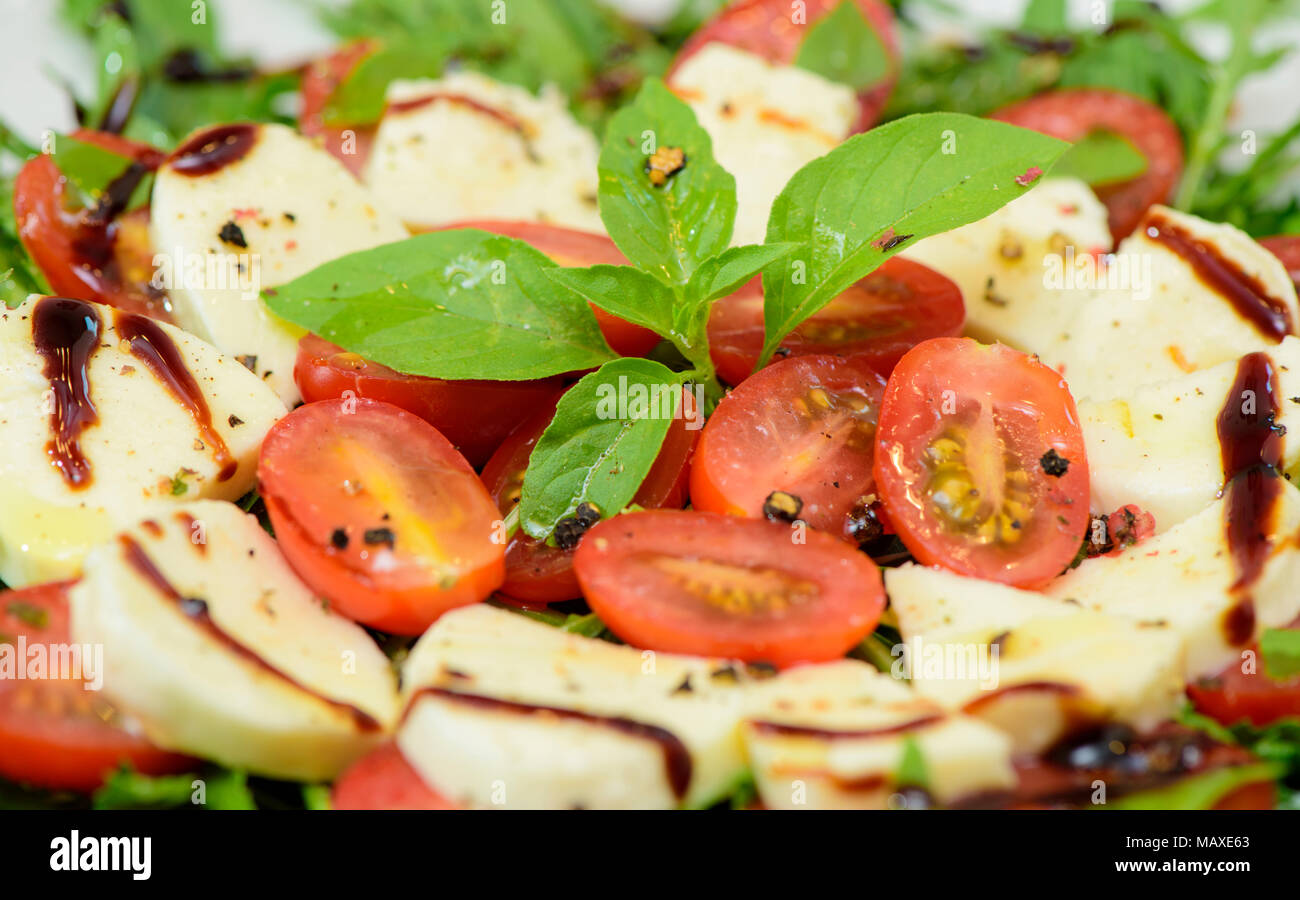 italian salad with rucola, mozzarella and tomatoes - Stock Image