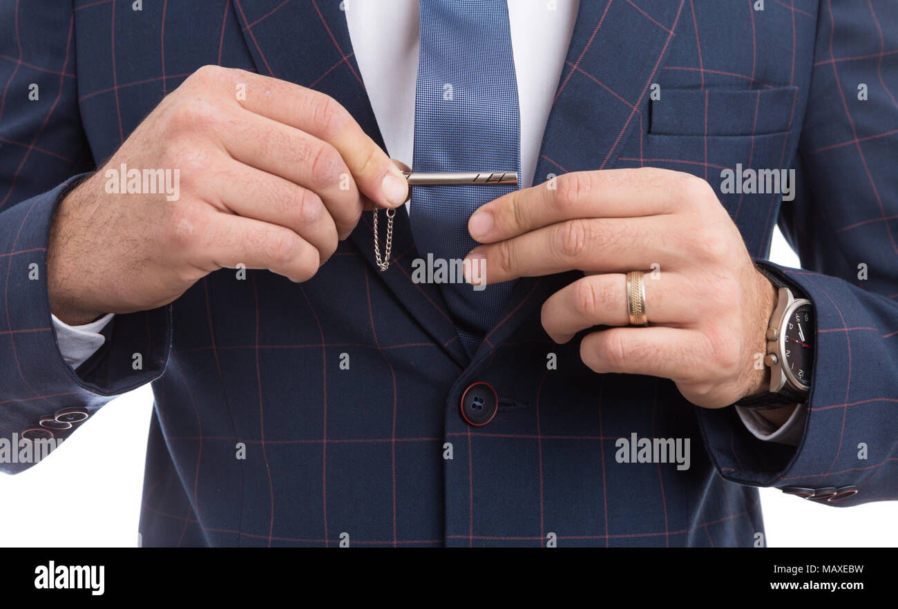 Man adjusting tie pin as fashion concept with luxury expensive suit Stock Photo