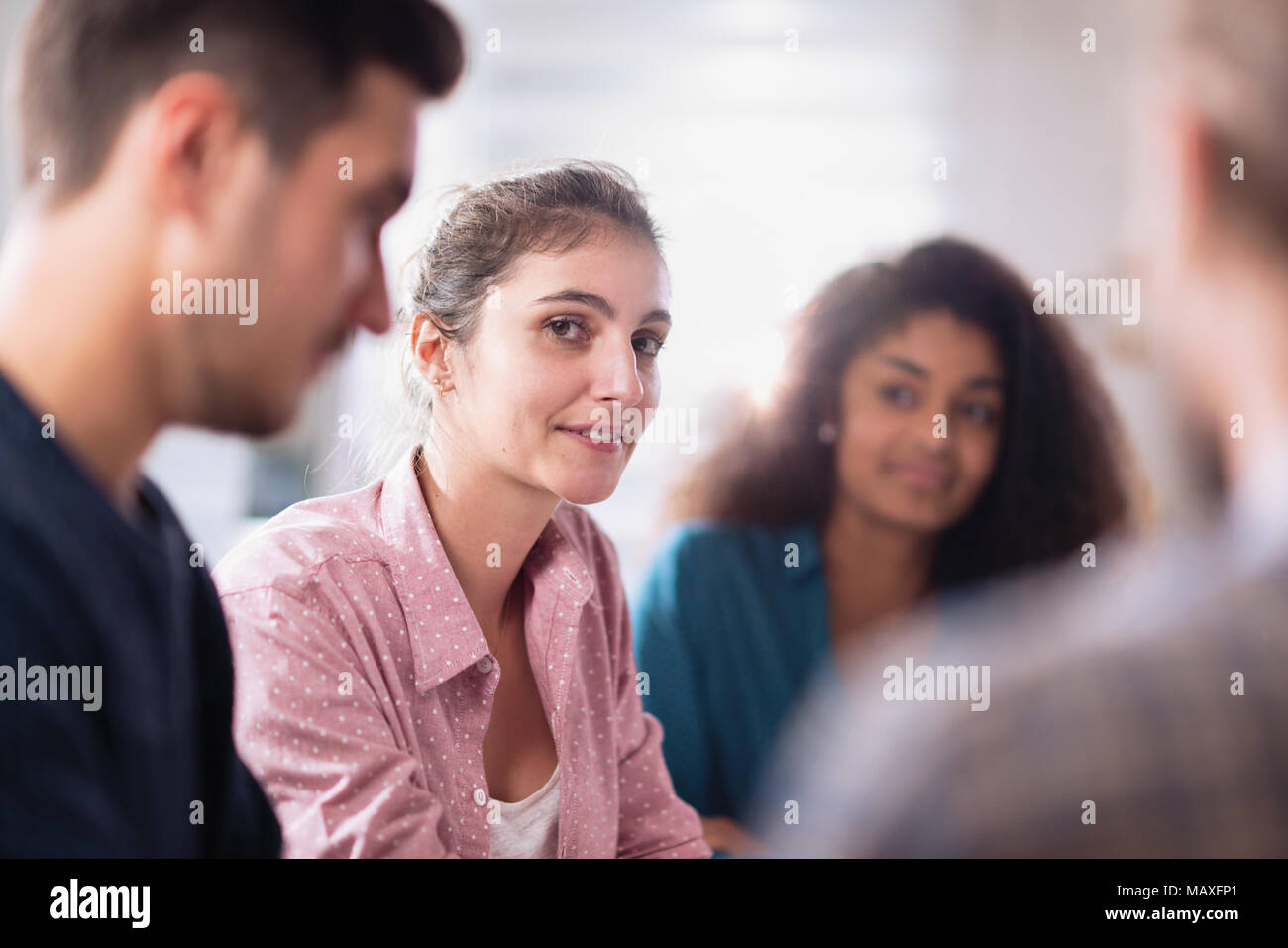 Meeting at the startup office . A working multiethnic group - Stock Image