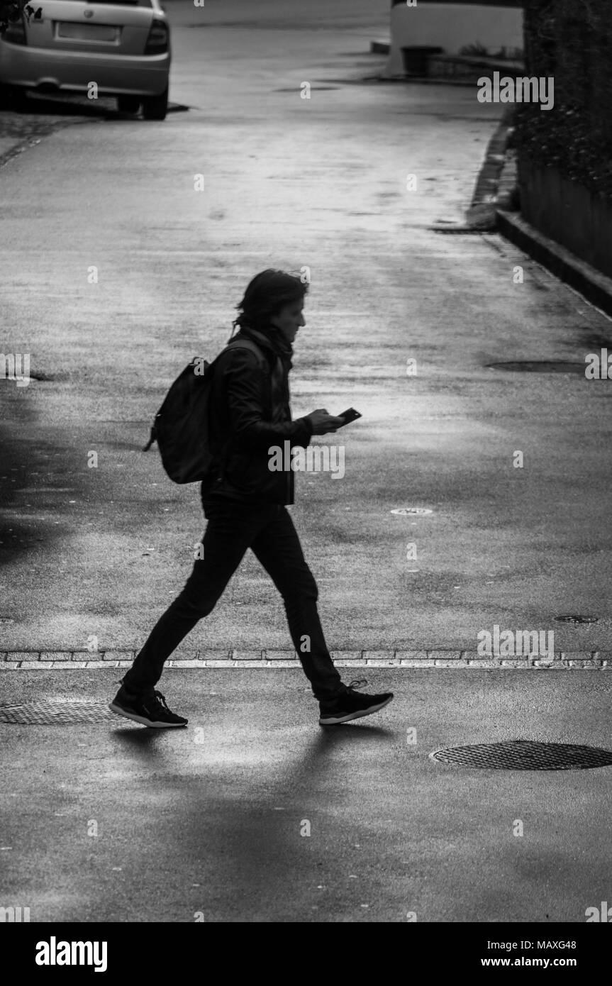 Man walking black&white - Stock Image