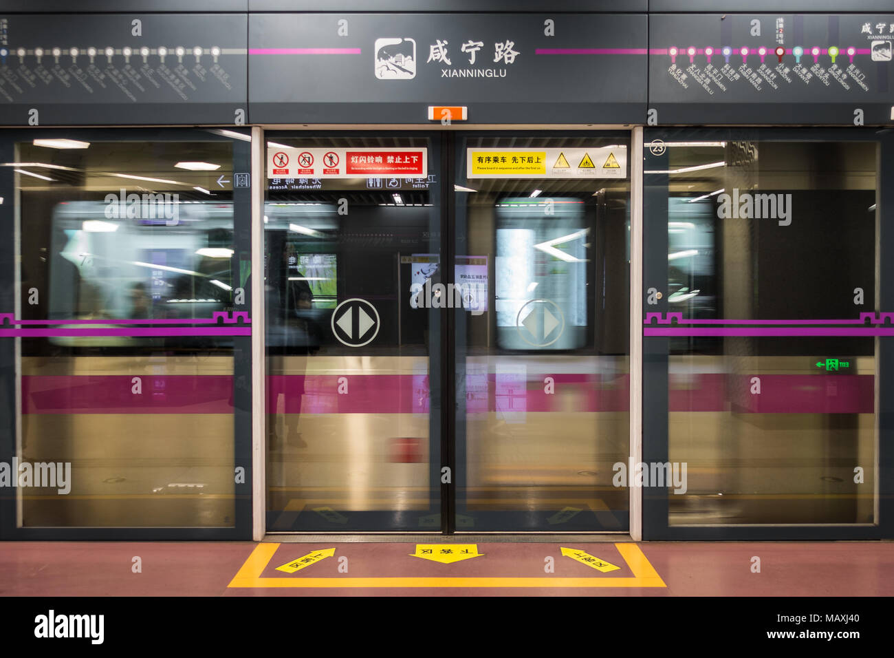 Xian Ning Lu Station with Passing Train Closed Doors in Xi'an, China, March 2018 Stock Photo