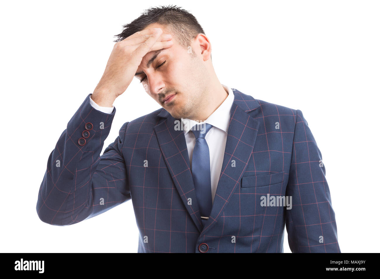Business person suffering migraine after stressful job grabbing forehead as hangover dizziness concept - Stock Image