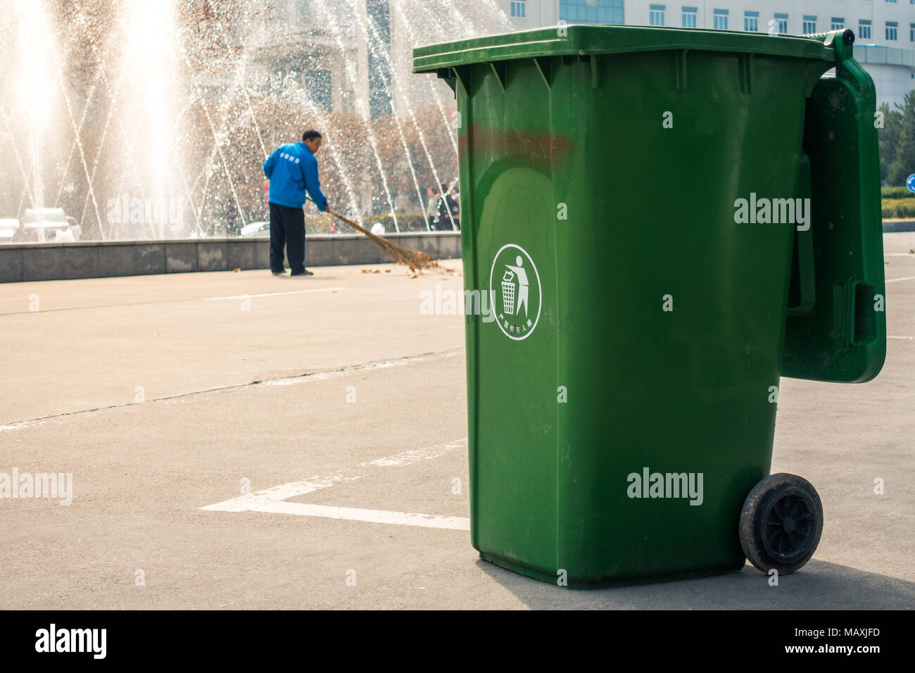 Chinese Trash Can Man Sweeping Behind Recyling University Campus In Xi An China March 2018 Stock Photo Alamy