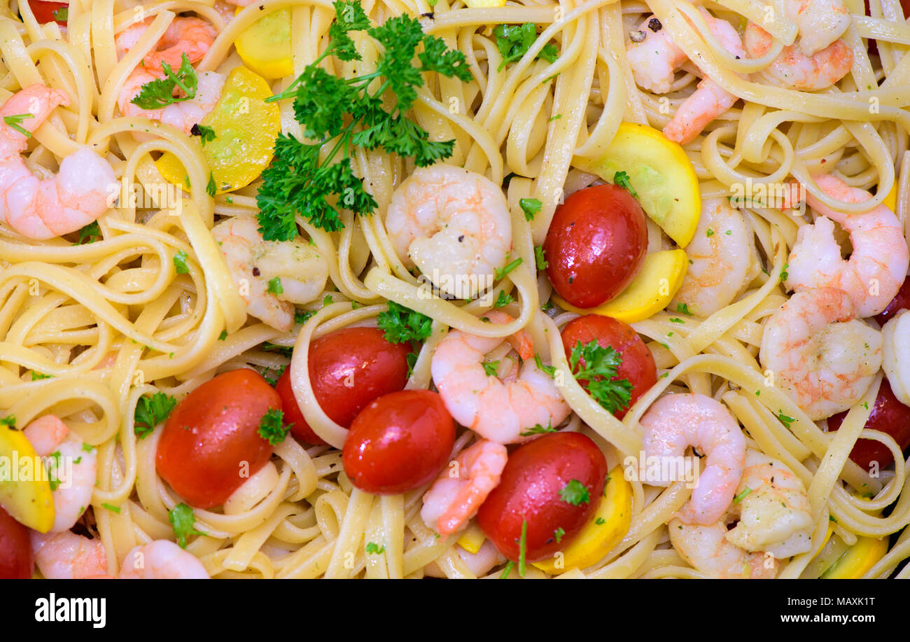 mediterran italian pasta with prawns and tomatoes Stock Photo
