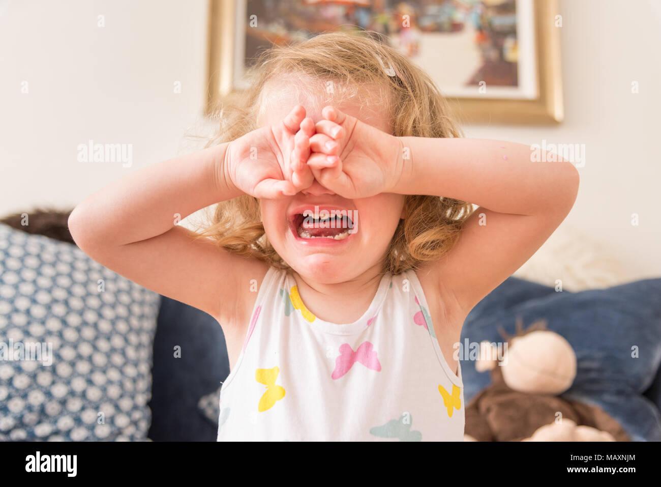Three year old child upset and crying, UK - Stock Image