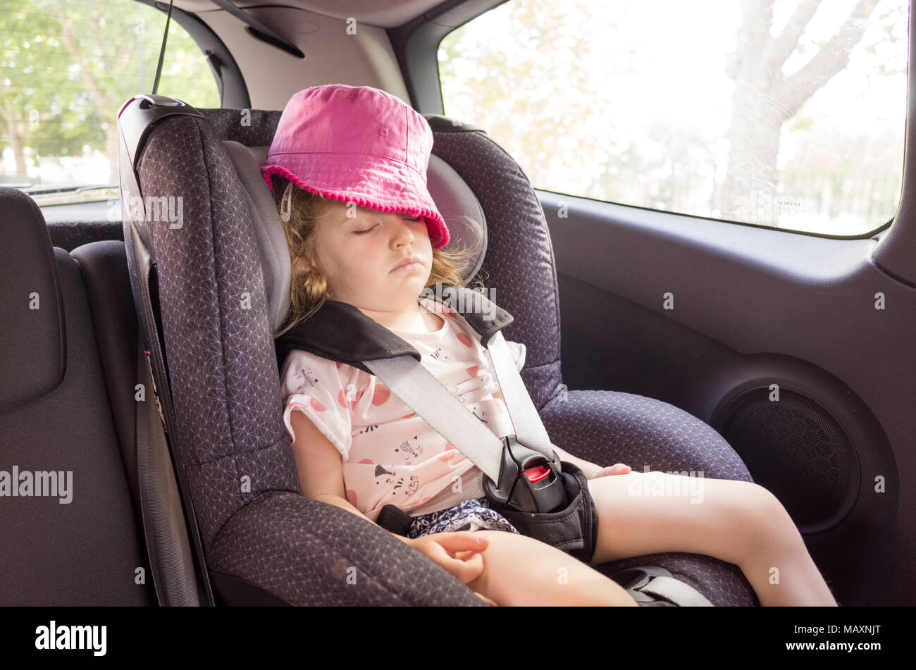 Three Year Old Child Asleep In The Car Seat Uk Stock Photo