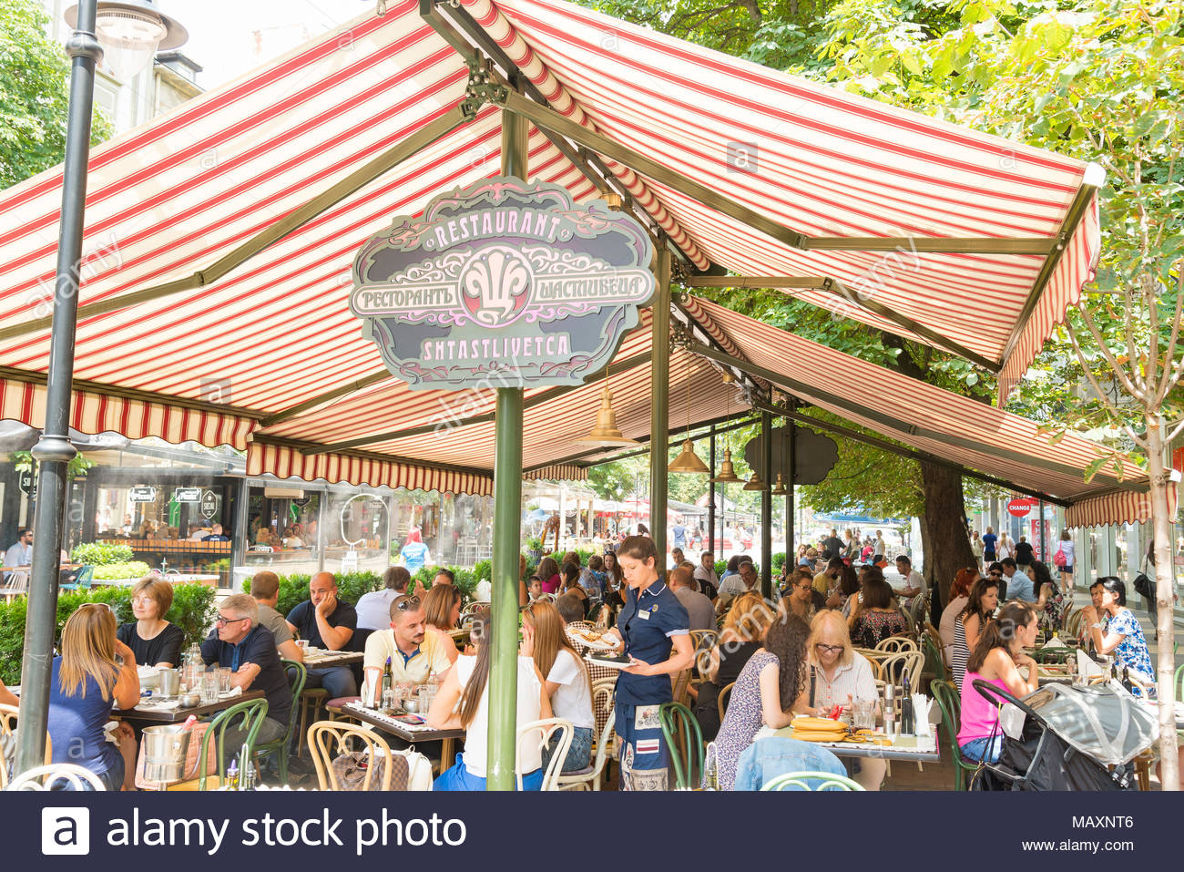 Alfresco restaurant tables in Vitosha Boulevard, Sofia, Bulgaria - Stock Image