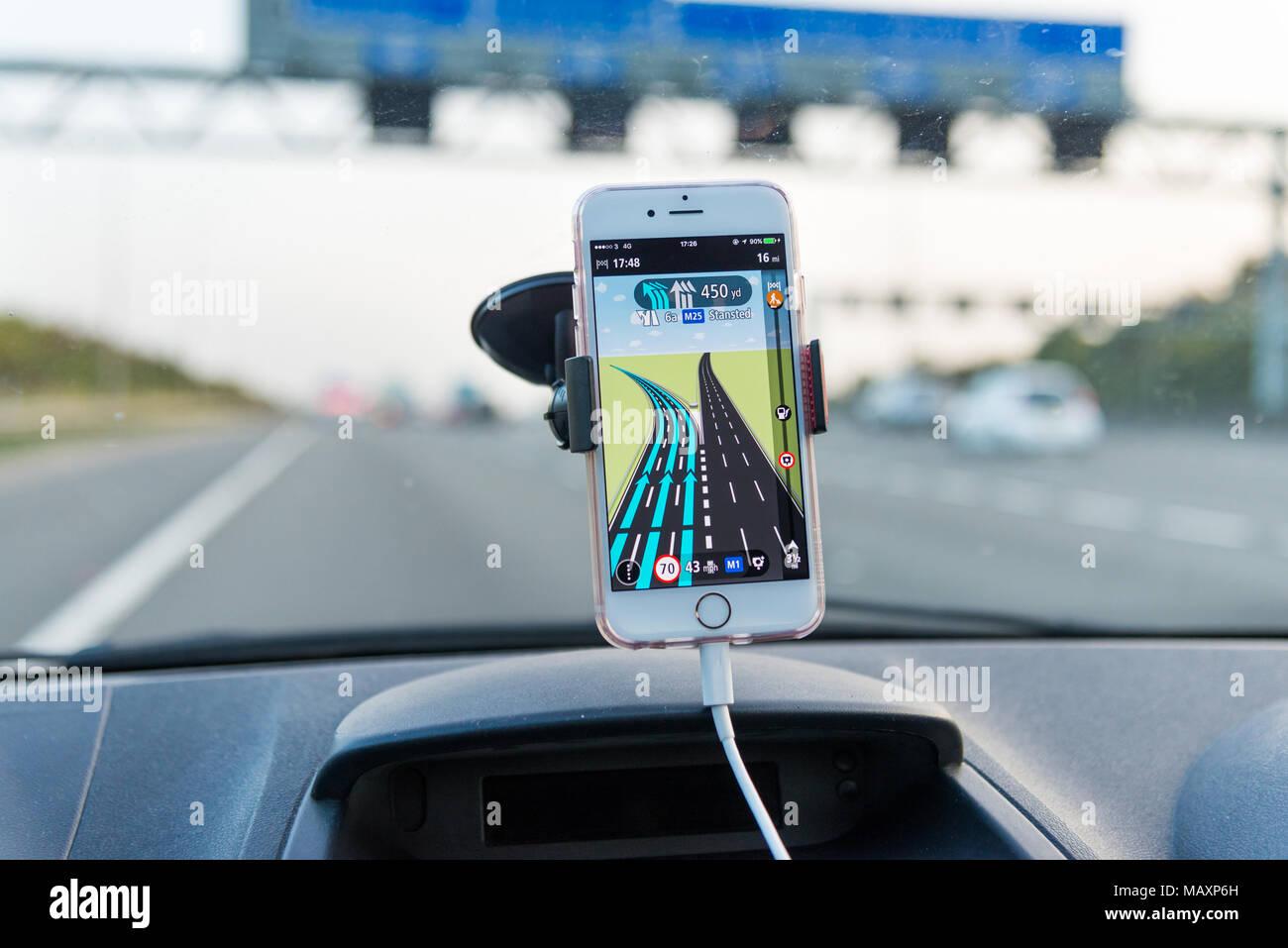 Using TomTom satnav app on iPhone while driving on M25 motorway, UK