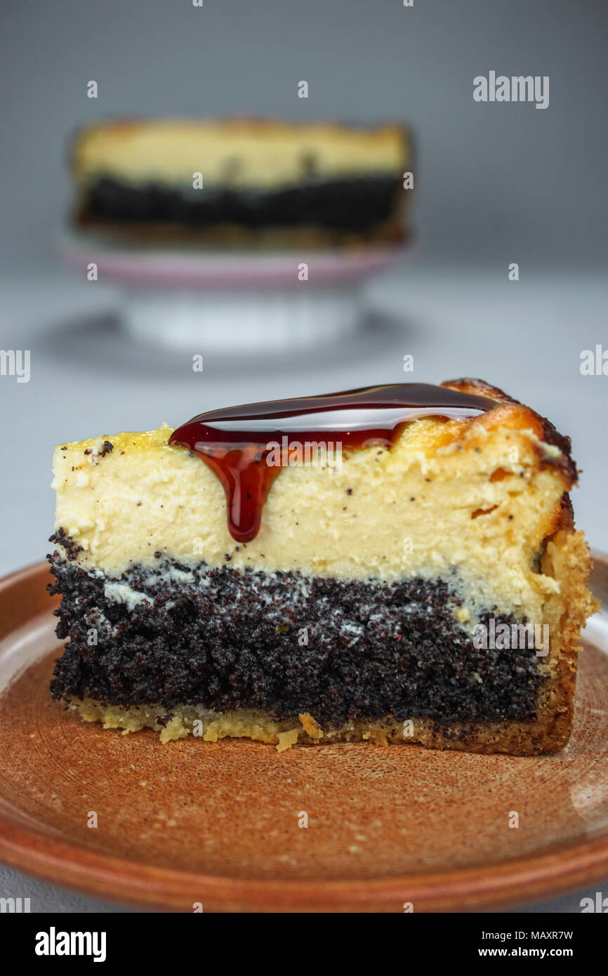 Cheesecake Slice With Poppy And Caramell - Stock Image