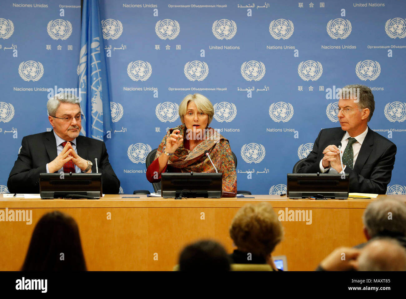 (180404) -- UNITED NATIONS, April 4, 2018 (Xinhua) -- Iraqi Permanent Representative to the United Nations Mohammed Hussein Bahr Aluloom (L, Rear), Director of the UN Mine Action Service (UNMAS) Agnes Marcaillou (C, Rear) and German Permanent Representative to the United Nations Christoph Heusgen (R, Rear), attend a press briefing on the occasion of the International Day for Mine Awareness and Assistance in Mine Action at the UN headquarters in New York, on April 4, 2018. UN Secretary-General Antonio Guterres on Wednesday called for action on landmines and asked governments to provide politica - Stock Image