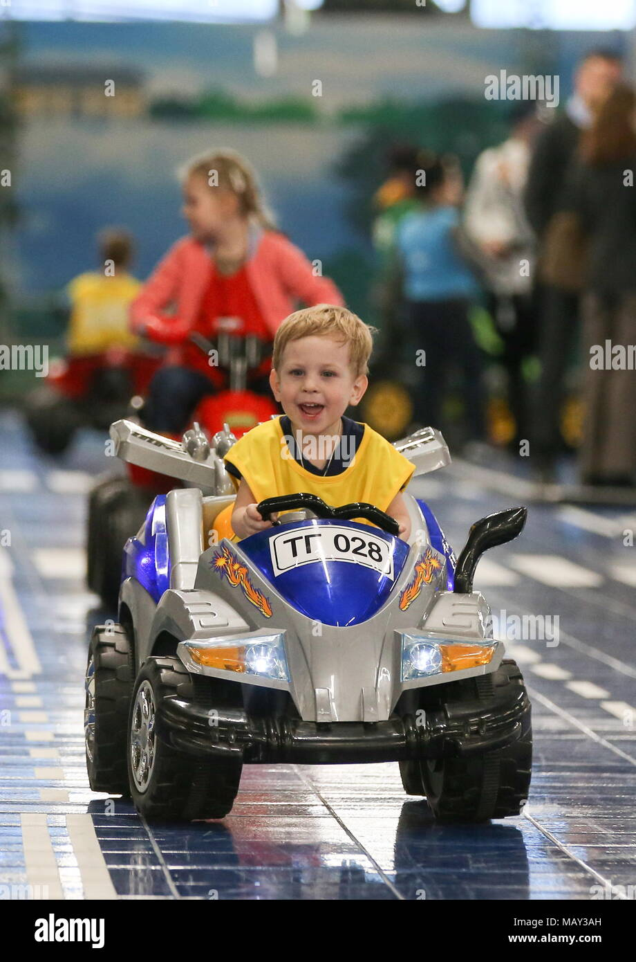 8c20cdc9cbe ST PETERSBURG, RUSSIA - APRIL 5, 2018: A boy driving an electric car at the  TachkiGrad children's center at the Continent Shopping Mall.