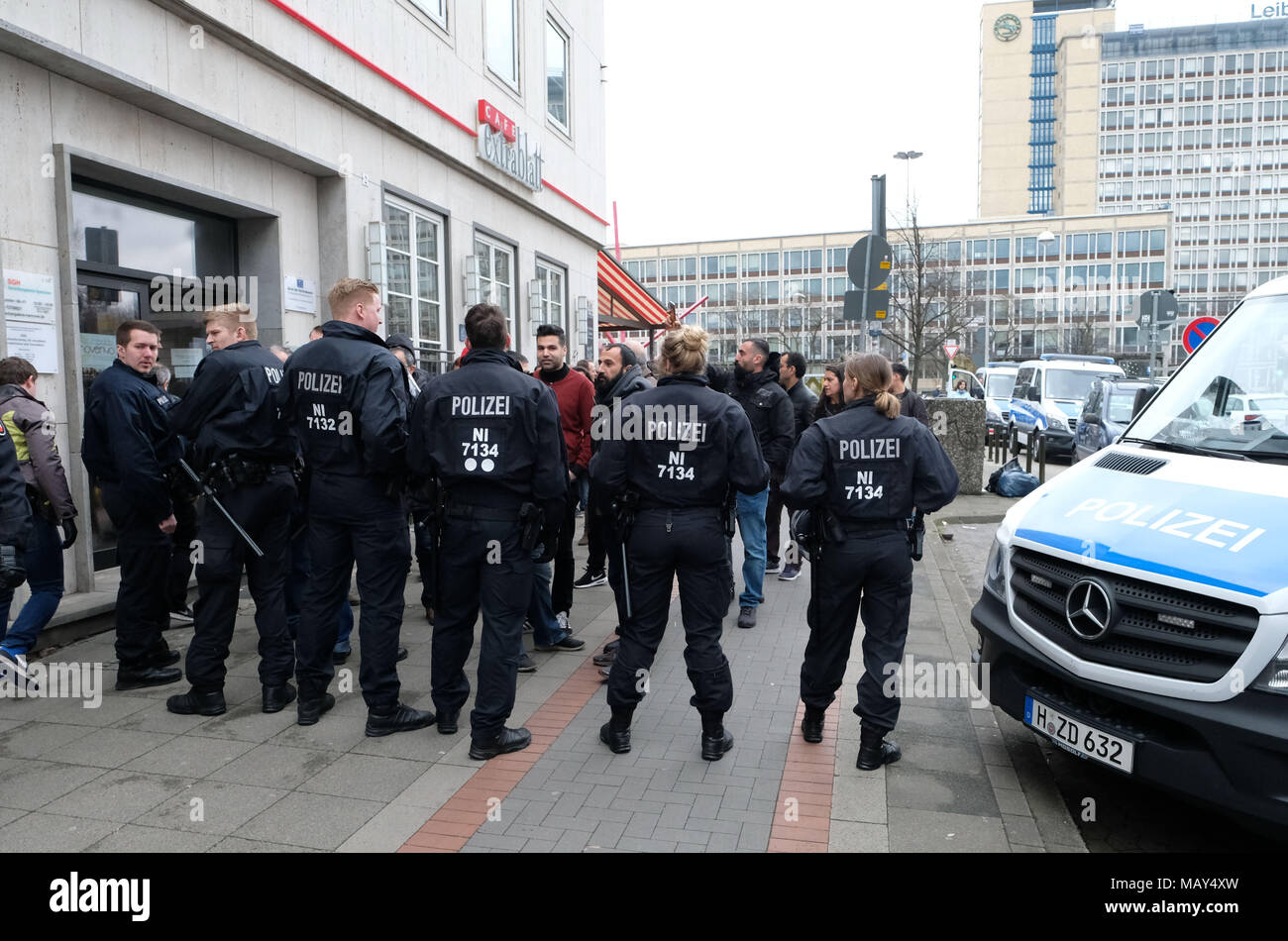Hannover, Germany. 05 April 2018, Germany, Hannover: Police officers standing during a raid in front of the building of the Kurdish democratic social centre in Hannover. The association is, according to itself, the umbrella organisation of the Kurdish People's Council. Photo: Peter Steffen/dpa Credit: dpa picture alliance/Alamy Live News - Stock Image